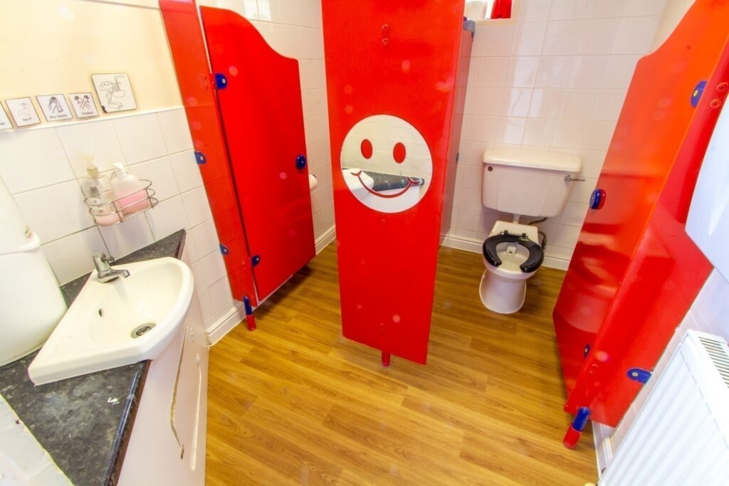 Children's bathroom – children develop independence in the bathroom with our low-level toilets and sink. Nappy changing facilities are provided here too.