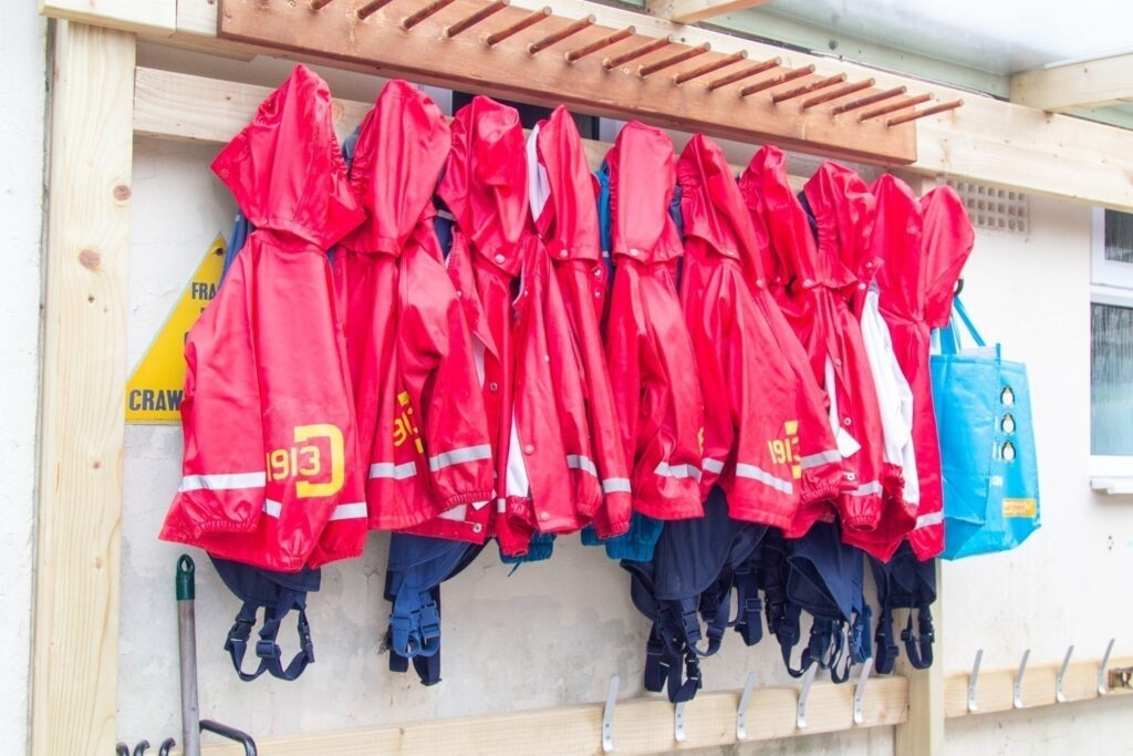 Our waterproofs! We provide a full set of waterproof clothes for each child so that we are able to play out in all weathers. Parents are asked to provide a pair of wellie boots that can stay with us for daily use.