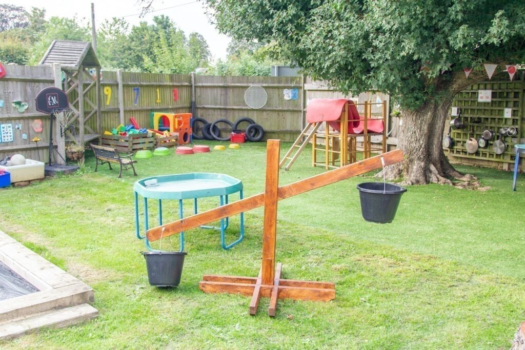 A view of our garden area - lots of opportunities to develop children's physical skills are provided.